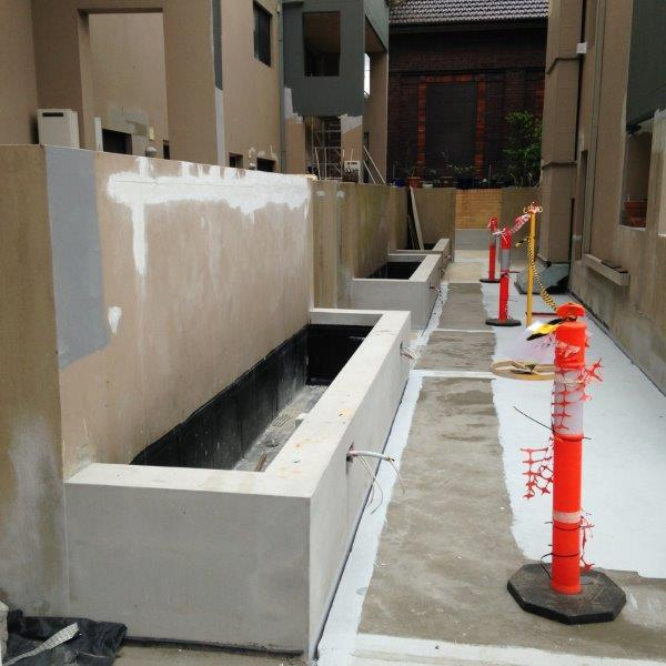 Relining and waterproofing the planting boxes for good drainage