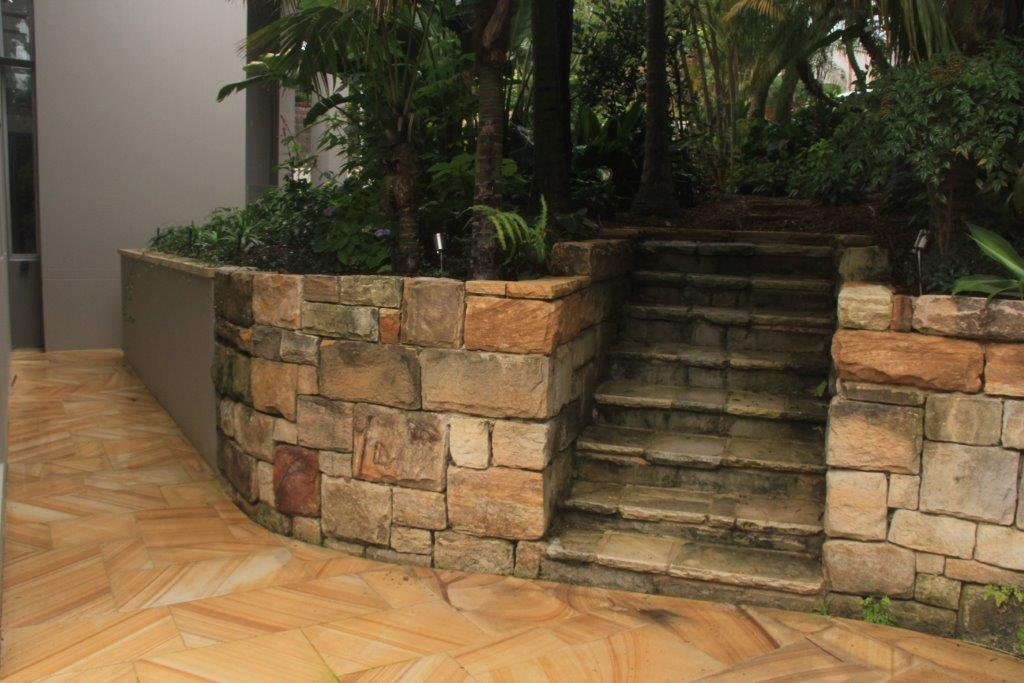 Sandstone retaining wall, stairs and pavers