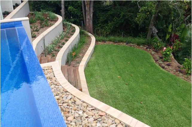Wet edge swimming pool tiered landscaping