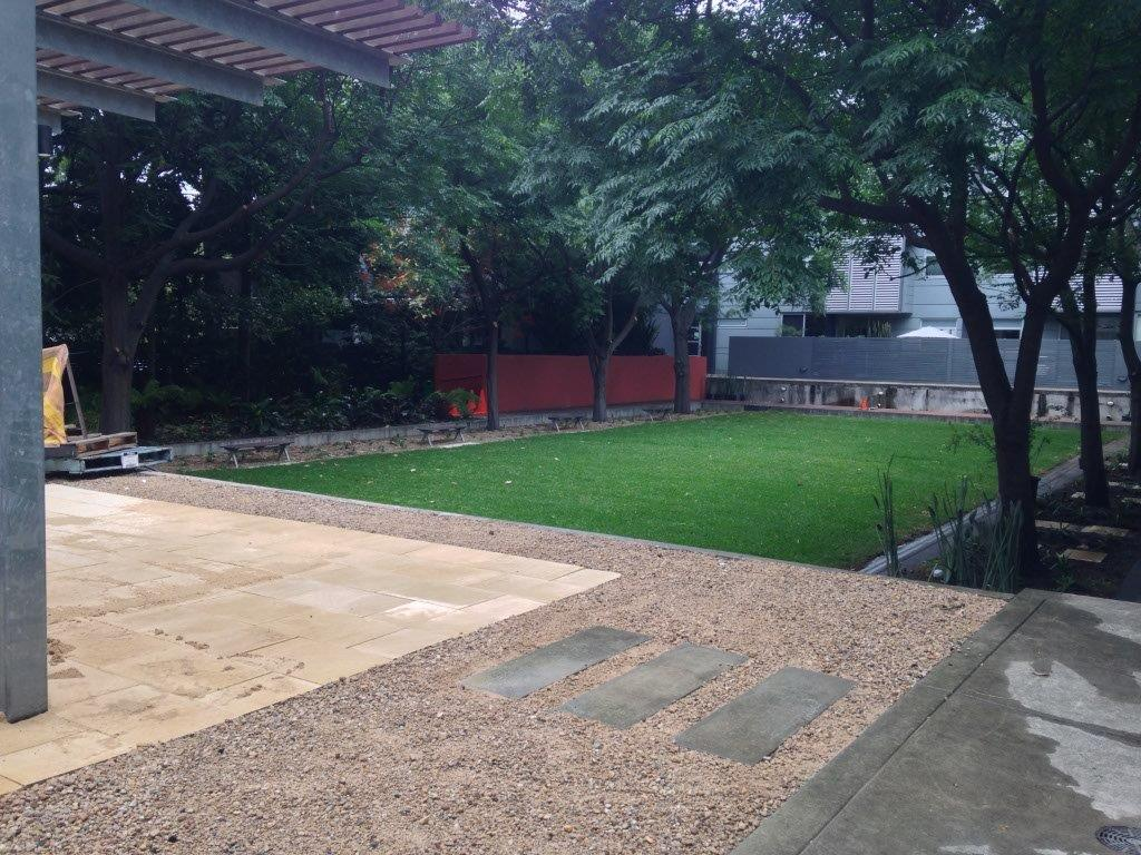 Landscape construction Sydney - hard surfaces and lawn