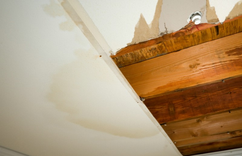 Water Damage Plasterboard Repairs storm damaged ceiling wall